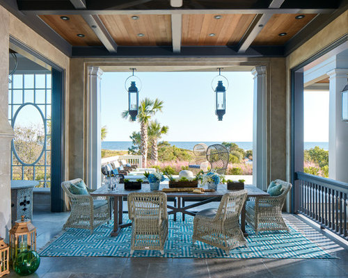 example of a large coastal gray three story stucco exterior home design in charleston with - Home Design Ideas