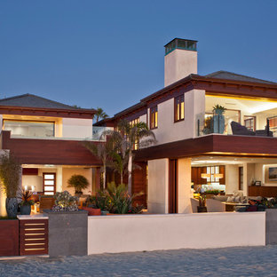 Large contemporary beige two-story wood exterior home idea in Los Angeles