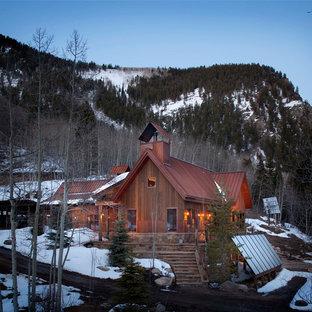 Rustic wood exterior home idea in Denver