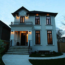 Traditional Exterior by Odenza Homes Ltd