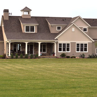 Inspiration for a mid-sized contemporary brown two-story mixed siding exterior home remodel in Cleveland with a shingle roof