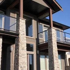 Contemporary Exterior by Sunterra Custom Homes