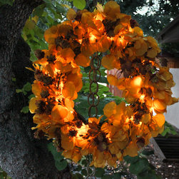 The Firefly Garden - Oktoberfest - Wreath - Oktoberfest Wreath is inspired by the rich colors of Autumn and the celebrations that come along with it. A lush yellow Aspen wreath is abundant with burgundy hops illuminated by warm amber LED lights.