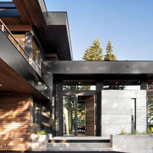Idéer för stora funkis grå hus, med två våningar, blandad fasad och platt tak