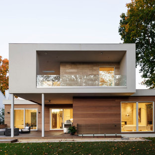 Mid-sized minimalist multicolored two-story mixed siding exterior home photo in New York