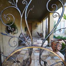 Mediterranean Exterior by Troy Rhone Garden Design