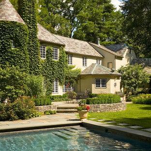 Mediterranean beige two-story exterior home idea in New York
