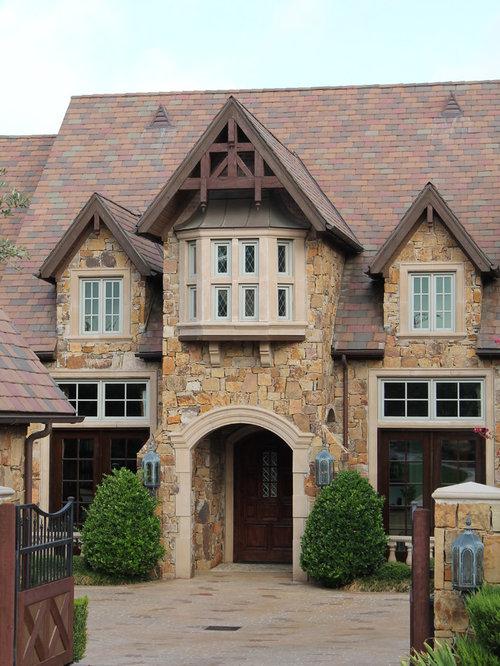 Example Of A Classic Stone Exterior Home Design In Dallas
