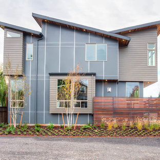 Contemporary two-story mixed siding exterior home idea in Portland with a shed roof