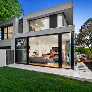 Inspiration for a contemporary two-storey multi-coloured house exterior in Melbourne with a flat roof.