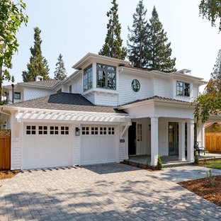 Elegant white two-story house exterior photo in San Francisco with a hip roof and a shingle roof