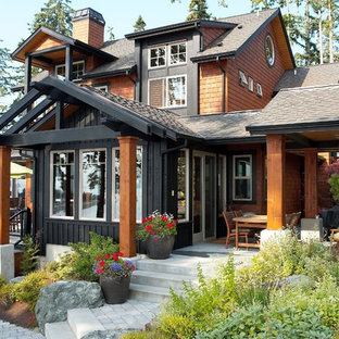Example of a mid-sized mountain style exterior home design in Seattle