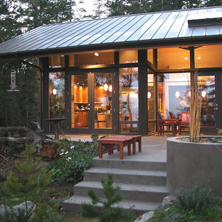 Inspiration for a rustic glass exterior home remodel in Seattle