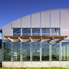 Industrial Exterior by Studio Momentum Architects, PC