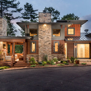 Example of a large trendy multicolored three-story mixed siding exterior home design in Other with a metal roof