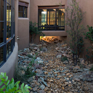 Inspiration for a large southwestern two-story adobe exterior home remodel in Phoenix