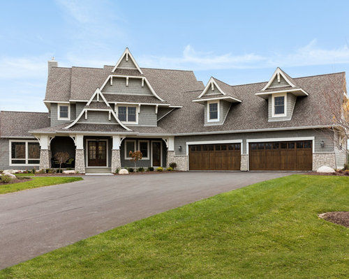example of a large coastal gray two story gable roof design in minneapolis with a - Home Exterior