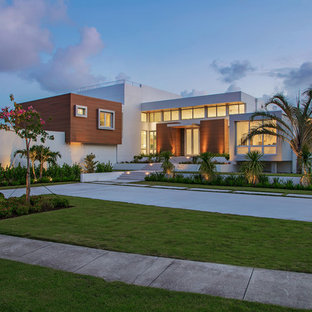 Large minimalist white two-story mixed siding exterior home photo in Tampa