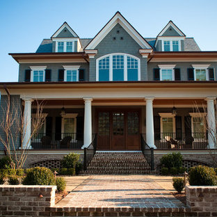 Example of a large classic blue three-story wood gable roof design in Charleston