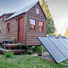 Rustic Exterior by The Tiny Tack House