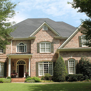 Example of a mid-sized tuscan red two-story brick exterior home design in Atlanta