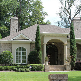 Example of a mid-sized tuscan beige one-story brick exterior home design in Atlanta