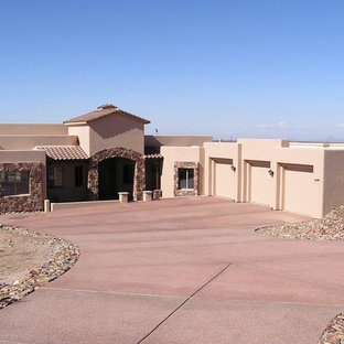 Large southwestern pink one-story stucco house exterior idea in Phoenix with a hip roof and a tile roof