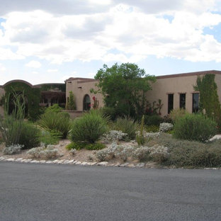 Mid-sized tuscan brown one-story stucco exterior home photo in Phoenix with a green roof
