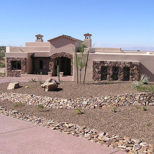 Inspiration for a large southwestern pink one-story stucco house exterior remodel in Phoenix with a hip roof and a tile roof