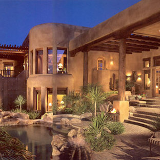 Mid-sized southwest brown two-story mixed siding exterior home photo in Phoenix