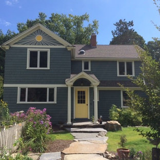 Inspiration for a mid-sized timeless blue two-story mixed siding gable roof remodel in Boston