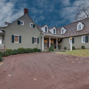 Inspiration for a large southwestern gray one-story wood exterior home remodel in Philadelphia with a shingle roof