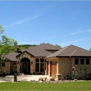 Mid-sized mediterranean black one-story mixed siding gable roof idea in Austin