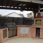 Brick Pizza Oven In Outdoor Kitchen With Ceramic Kamado