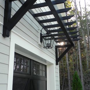 Example of a mid-sized country gray two-story vinyl exterior home design in Charlotte with a shingle roof