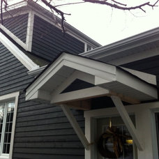 Traditional Exterior by K WINN Custom Building Group Inc.