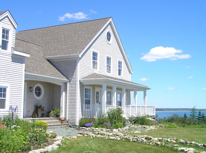 Beach Style Exterior by NC Designs