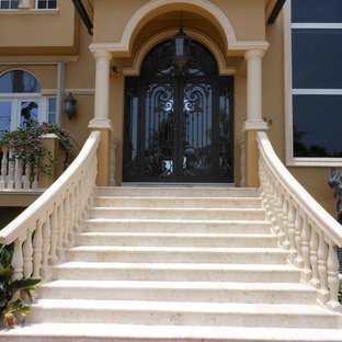 Example of an island style exterior home design in Miami