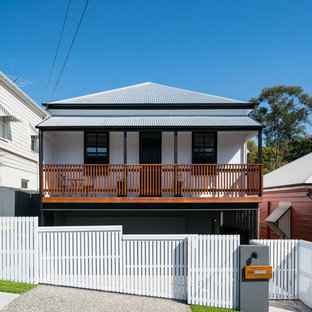 Design ideas for a contemporary two-storey white exterior in Brisbane with mixed siding and a hip roof.