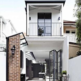Стильный дизайн: двухэтажный дом среднего размера в современном стиле - последний тренд