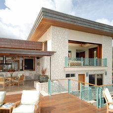 Tropical Exterior by Archipelago Hawaii Luxury Home Designs