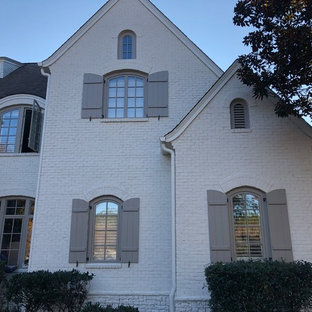 Mid-sized transitional white two-story brick exterior home idea in Atlanta with a shingle roof