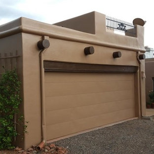 Example of a large southwest brown one-story stucco exterior home design in Phoenix with a tile roof