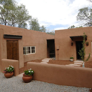 Example of a southwest adobe flat roof design in Albuquerque