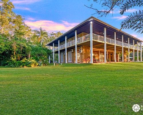 Tropical brown exterior design ideas renovations photos for Tropical exterior house colors