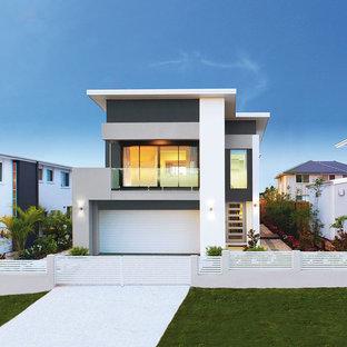 Inspiration för mellanstora moderna hus, med två våningar och platt tak