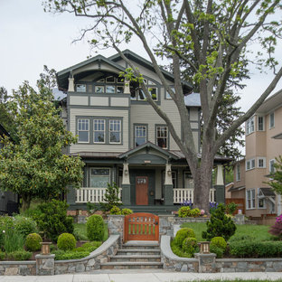 Craftsman green three-story gable roof idea in DC Metro