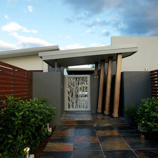 Design ideas for a beige contemporary exterior in Brisbane with mixed cladding.