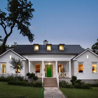 Farmhouse concrete exterior home photo in Austin