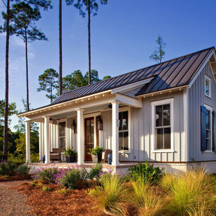 Photo of a small and gey farmhouse one floor house exterior in Charleston with concrete fibreboard cladding.